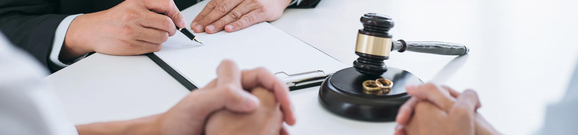 A lawyer signing divorce documents